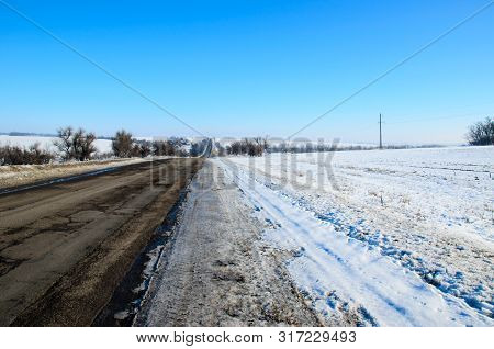 Asphalt Road In A Coutryside On Winter