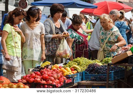 Women Buy Fruit During The Autumn Food Fair In Uzhgorod, Ukraine, September 15, 2018.