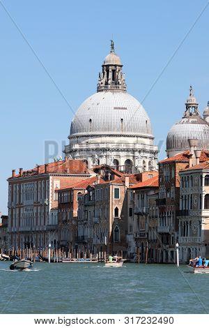 Big Dome Of Madonna Della Salute Church And Boats In Venice Italy