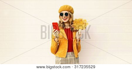 Autumn Portrait Smiling Woman Holding Phone, Yellow Maple Leaves Wearing French Beret On City Street