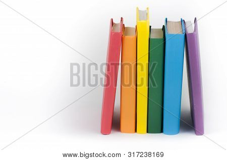 Book Stacking. Open Book, Hardback Books On White Background. Back To School. Copy Space For Text.