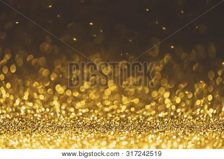 Gold Glitter Sparkle Lights Background. Defocused Glitter Abstract Twinkly Light And Shiny Stars. Ch