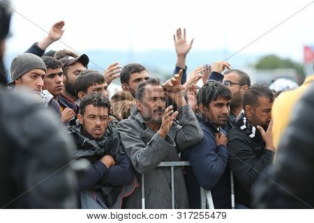 Bregana, Slovenia - September 20, 2015 : A Group Of Male Syrian Refugees At The Slovenian Border Wit