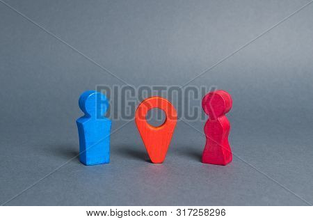 A Red Navigation Location Pointer Indicates The Meeting Place Between Man And Woman. Choosing A Plac