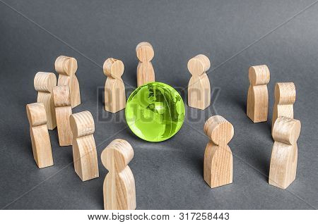 People Surrounded A Glass Globe. Cooperation And Collaboration Of People Around The World. Outsourci