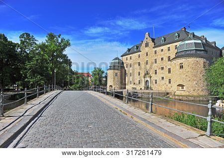 Old Castle And Pavement Bridge In Orebro