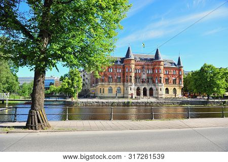 View Of Historical Building By The River In City Centre Of Orebro