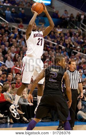 LOS ANGELES - MARCH 12: Arizona Wildcats G Kyle Fogg #21 shoots over Washington Huskies G Isaiah Thomas #2 during the NCAA Pac-10 Tournament championship game on March 12 2011 at Staples Center.