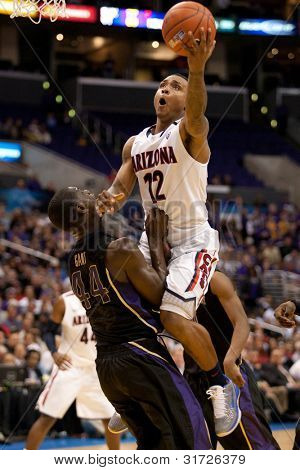 LOS ANGELES - MARCH 12: Arizona Wildcats G Lamont Jones #12 & Washington Huskies forward Darnell Gant #44 during the NCAA Pac-10 Tournament championship game on March 12 2011 at Staples Center.