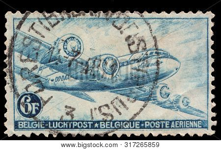 Postage stamp printed in Belgium, dedicated to domestic airmail. Circa 1930 poster