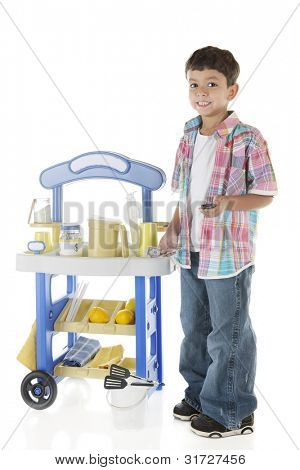 An adorable preschooler proudly standing by his lemonade stand with some of his earnings in his hand.  On a white background.