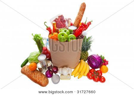 A paper bag full of groceries, surrounded by fruits, vegetables, bread, bottled beverages, and canned goods. studio isolated on white background.