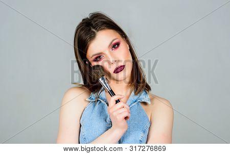 Attractive Woman Applying Makeup Brush. Professional Makeup Supplies. Makeup Artist Concept. Emphasi