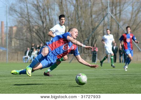 KAPOSVAR, HUNGARY - MARCH 17: Unidentified players in action at the Hungarian National Championship under 18 game between Kaposvar (white) and Videoton (blue), March 17, 2012 in Kaposvar, Hungary.