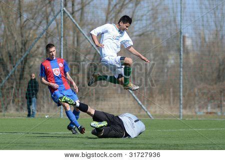 KAPOSVAR, HUNGARY - MARCH 17: Daniel Kara (goalkeeper) in action at the Hungarian National Championship under 18 game between Kaposvar (white) and Videoton (blue), March 17, 2012 in Kaposvar, Hungary.