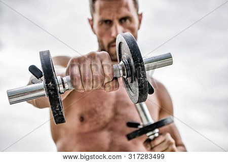 Healthy Mind In A Healthy Body. Muscular Man Exercising With Dumbbell. Dumbbell Exercise. Dare To Be