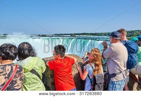 Niagara Falls, Canada - July 25, 2019: People Taking Selfie Over Niagara Falls On A Beautiful Clear