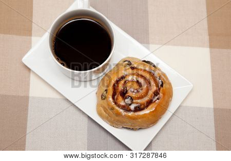 Homemade Cinnamon Swirls And A Coffee Homemade Cinnamon Swirl Bread Rolls On A Plate With A Cup Of C