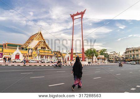 An Asian Tourist Is Walkig Along Street At The Giant Swing Or Sao Ching Cha The  Landmark Of Bangkok