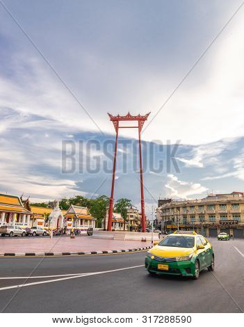 A Taxi Green Yellow On Street At The Giant Swing Or Sao Ching Cha The  Landmark Of Bangkok City. Tha