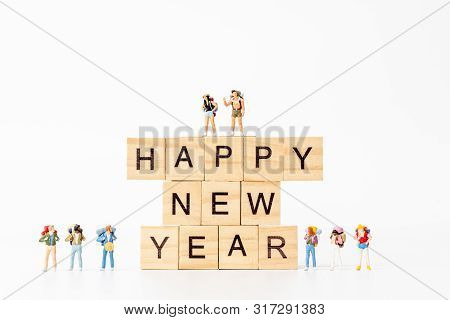 Miniature People : Group Of Backpacker Standing On Wooden Block  Happy New Year Concept