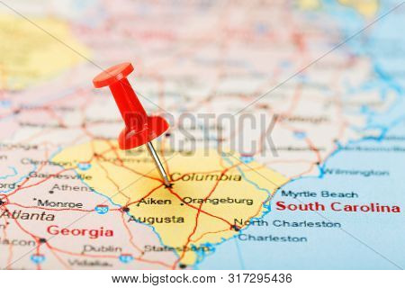Red Clerical Needle On A Map Of Usa, South South Carolina And The Capital Columbia. Close Up Map Of