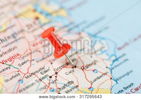 Red Clerical Needle On A Map Of Usa, South North Carolina And The Capital Raleigh. Close Up Map Of S