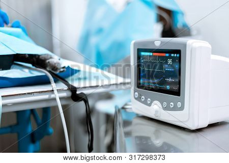 Heart Rate Monitor In Hospital Theater. Medical Vital Signs Monitor Instrument In A Hospital On Anes