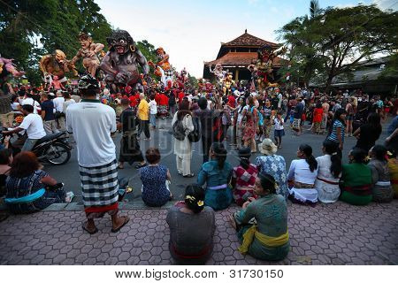 BALI, INDONESIA - MARCH 22: People on square ready to start Hindu Ngrupuk parade on March 22, 2012 in Ubud, Bali. Hindu Ngrupuk rituals  is performed in order to vanquish the negative spirits