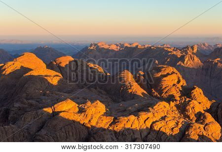 Amazing Sunrise at Sinai Mountain, Beautiful dawn in Egypt, early morning view of the top of Mount Moses poster