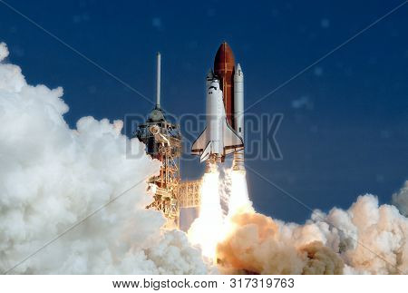 The Launch Of The Space Shuttle. With Fire And Smoke. Against The Background Of The Starry Sky. Elem