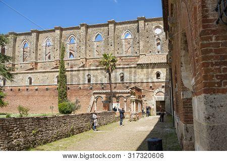 Chiusdino, Italy - April 30, 2019: Tourist Before Old Ruins Of Abbey San Galgano  On April 30,2019 I