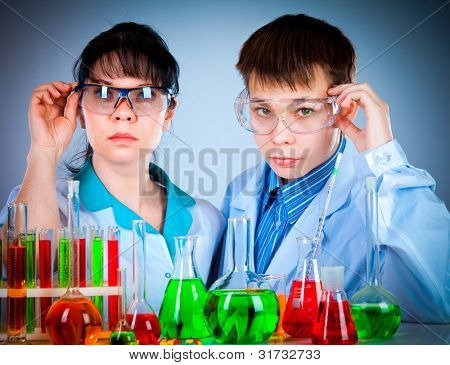 schoolteacher and student working in the lab
