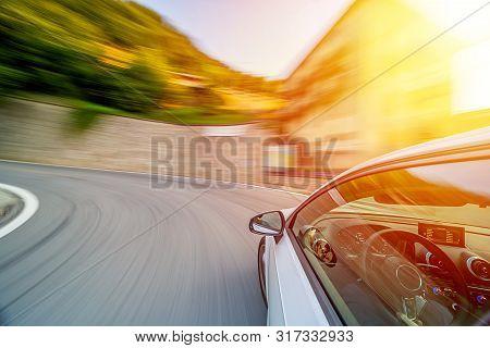 Car In U Turn Motion Blur Driving In The Italian Mountains