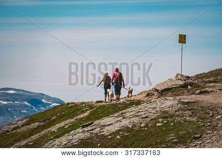 July 26, 2019. Norway Tourist Route On The Trolltunga. People Tourists Go Hiking In The Mountains Of