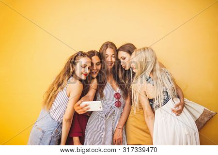 A group of girl taking selfie