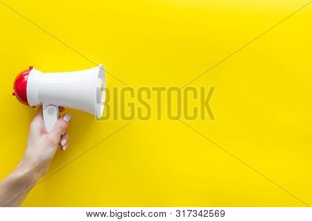 Announcement With Megaphone In Hand On Yellow Background Top View Mockup
