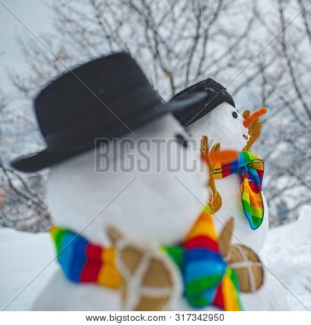 Making Snowman And Winter Fun. Snowman On A Background Snow-covered Fir Branches. Snowman And Snow D