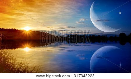 The Romantic Moon Over Water . Crescent Moon With Beautiful Sunset Background . Generous Ramadan . N