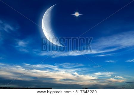 Beautiful Dark Fluffy Cloudy Sky With Sun Rays . Crescent Moon With Beautiful Sunset Background . Ge