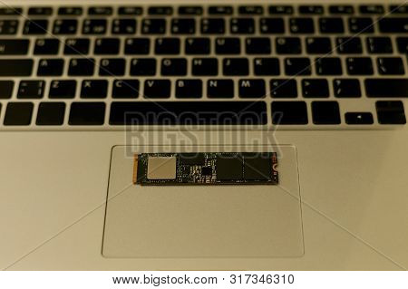 Ssd Drive Chip On The Bottom Of The Laptop. Horizontally On The Trackpad. The Bottom Buttons Are Not