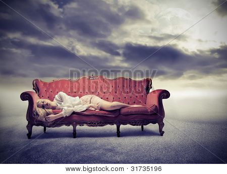 Sad woman lying on a sofa poster