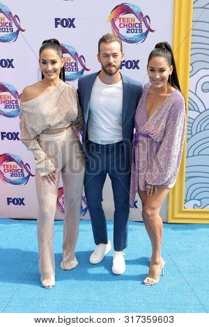 LOS ANGELES - AUG 11:  Artem Chigvintsev, Nikki Bella, Brie Bella at the Teen Choice Awards 2019 at Hermosa Beach on August 11, 2019 in Hermosa Beach, CA