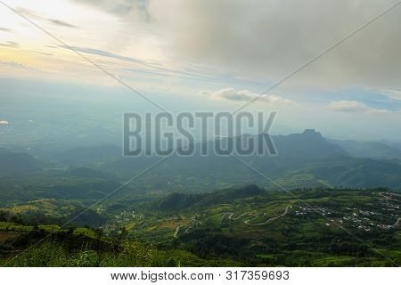 The Mountain Views Of Phu Thap Boek Are Foggy And The Morning Sun.
