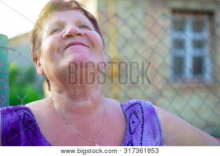 Happy 60 Year  Old Age Concept Village Grandmother Rejoices And Looks To The Sky Short Haired   Gran