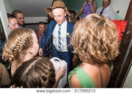 Kirov, Russia - July 27, 2018: Groom During The Fun Of The Brides Ransom. Part Of Traditional Russia