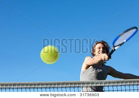 Young active man playing tennis