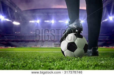 Soccer Player Foot Close Up In A Stadium During Football Match Under Bright Spotlights