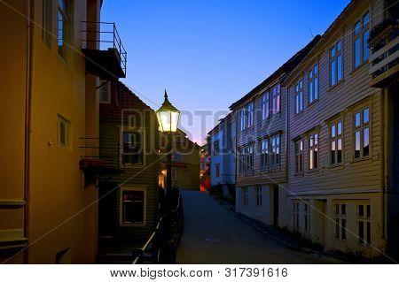 Bergen, Norway - July 26, 2019: Small Street By Night In Bergen, Way To The Top Of Mount Floyen.