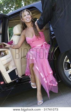 Girl Dressed for Dance Getting Out of Limo
